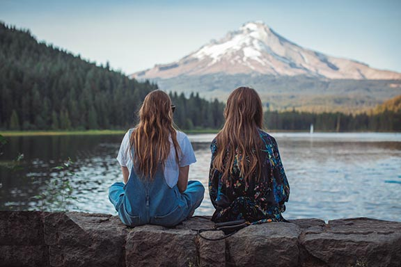 Two Women Looking at a Mountain