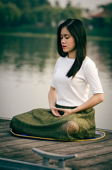 Woman Sitting in Meditaion